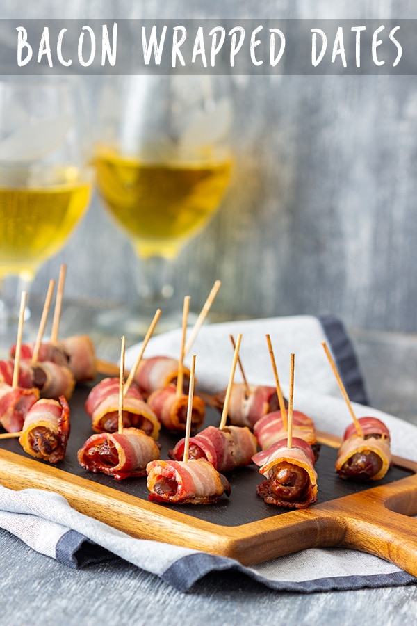 Bacon wrapped dates are easy to make appetizers ready in minutes. They are delicious on their own or with a dip of your choice. Enjoy them warm or cold! #appetizeraddiction #bacon #wrapped #dates #recipe #appetizers #partyfood