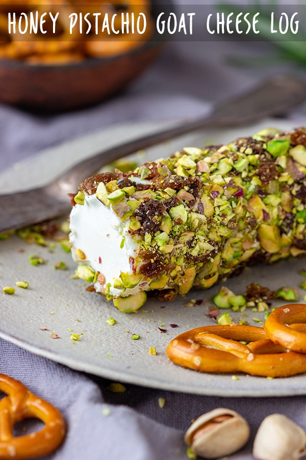 Honey Pistachio Goat Cheese Log is an easy appetizer ready in 5 minutes! Soft goat cheese with pistachio, raisin and honey crust is perfect for any occasion! #appetizeraddiction #honey #pistachio #goatcheese #log #appetizer #recipe #partyfood #partyfood