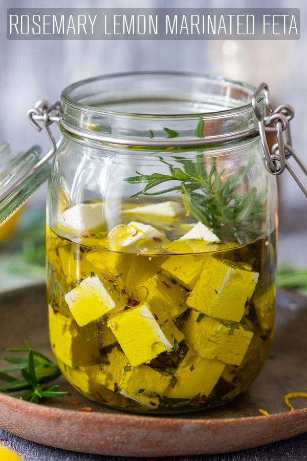 Rosemary marinated feta cheese is the perfect make-ahead appetizer. Feta and olive oil are infused with rosemary, lemon peel and chili flakes. #appetizeraddiction #marinated #feta #cheese #recipe #rosemary #lemon #oliveoil #chili #appetizers #homemade