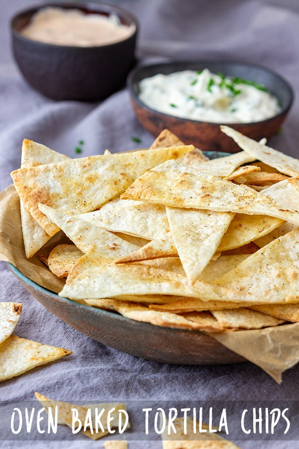 Homemade oven baked tortilla chips are an easy and healthy snack. Their prep only takes minutes and so does the baking. They go so well with all sorts of dips! #appetizeraddiction #baked #tortilla #chips #snack #recipe #partyfood