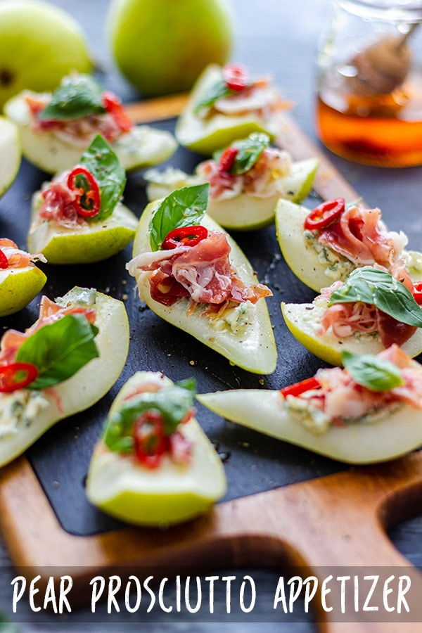 Need quick and easy appetizers for the Holidays or New Year's Eve Party? Try this pear prosciutto appetizer recipe. These prosciutto bites are ready in 10 minutes and require no baking! #partyfood #appetizers #appetizerrecipes #pear #prosciutto