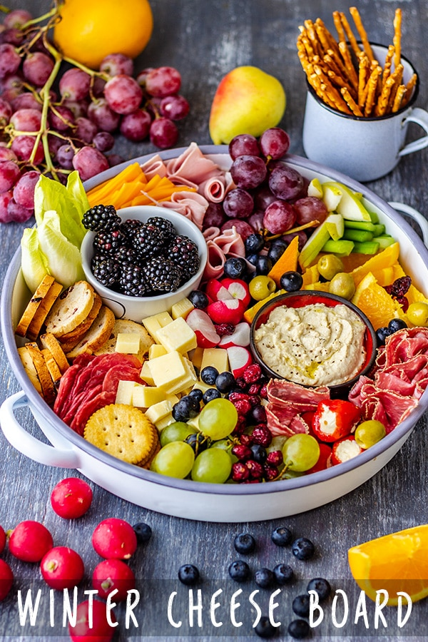 Winter cheese board is the perfect solution for entertaining at home this holiday season. Includes tips on how to make the best cheese board! #cheeseboard #holidayappetizers #appetizers #appetizerrecipes