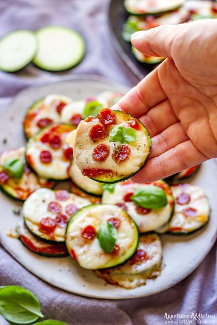 Zucchini Pizza Bites on the Hand
