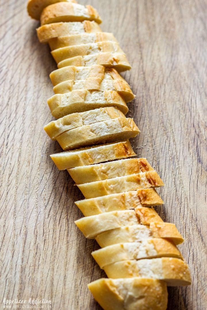 Sliced baguette on the wooden board