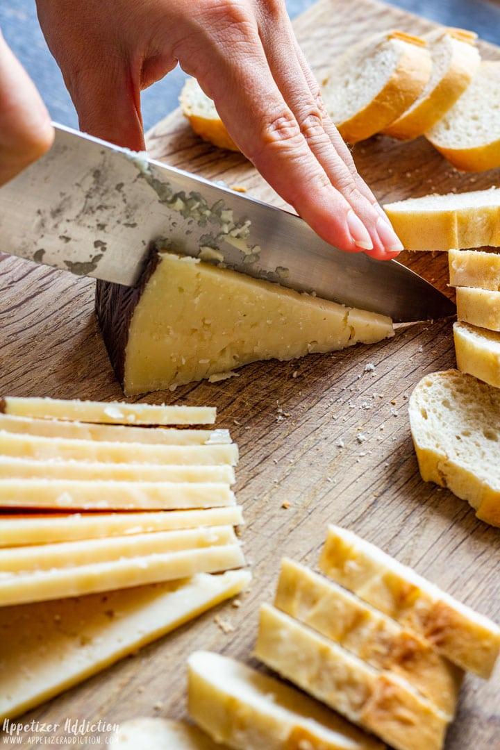 Slicing Spanish Manchego cheese